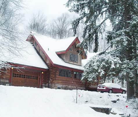snow view of rental home in saranac lake, ny