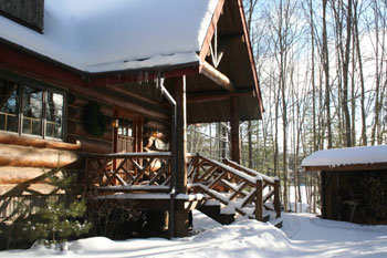 snow on front porch adk log rental home